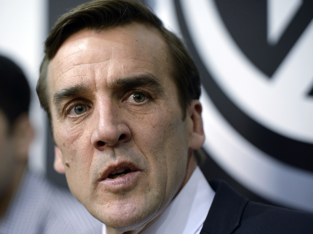 Washington Capitals former general manager George McPhee speaks during a news conference in Arlington, Va., Monday, April 28, 2014. (AP Photo)