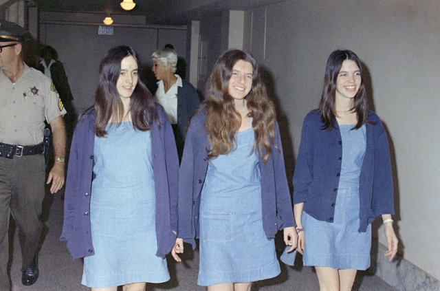 In this Aug. 20, 1970 file photo, Charles Manson followers, Susan Atkins, Patricia Krenwinkel and Leslie Van Houten, walk to court to appear for their roles in the 1969 cult killings of seven peop ...