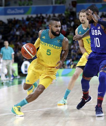 Australia's Patty Mills (5) drives around United States' Kyrie Irving (10) during a men's basketball game at the 2016 Summer Olympics in Rio de Janeiro, Brazil, Wednesday, Aug. 10, 2016. (Eric Gay/AP)