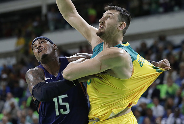 United States' Carmelo Anthony (15) and Australia's Andrew Bogut (6) jockey for position during a men's basketball game at the 2016 Summer Olympics in Rio de Janeiro, Brazil, Wednesday, Aug. 10, 2 ...