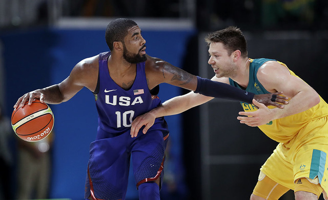 United States' Kyrie Irving (10) drives around Australia's Matthew Dellavedova during a basketball game at the 2016 Summer Olympics in Rio de Janeiro, Brazil, Wednesday, Aug. 10, 2016. (Charlie Ne ...
