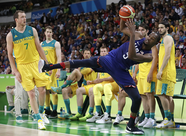 United States' Kevin Durant (5) is fouled by Australia's Joe Ingles (7) during a basketball game at the 2016 Summer Olympics in Rio de Janeiro, Brazil, Wednesday, Aug. 10, 2016. (Charlie Neibergal ...
