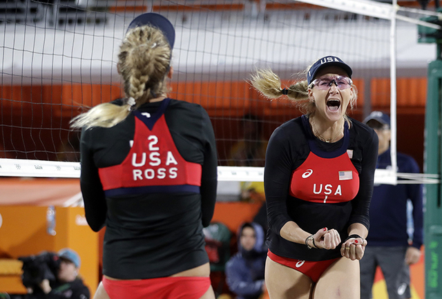 United States' April Ross, left, and Kerri Walsh Jennings celebrate a point against Switzerland during a women's beach volleyball match at the 2016 Summer Olympics in Rio de Janeiro, Brazil, Wedne ...