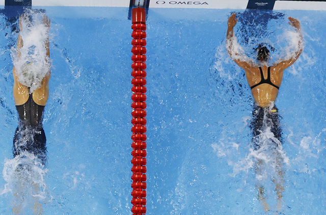 Spain's Mireia Belmonte Garcia touches the wall before Australia's Madeline Groves, left, in the women's 200-meter butterfly finals during the swimming competitions at the 2016 Summer Olympics, We ...