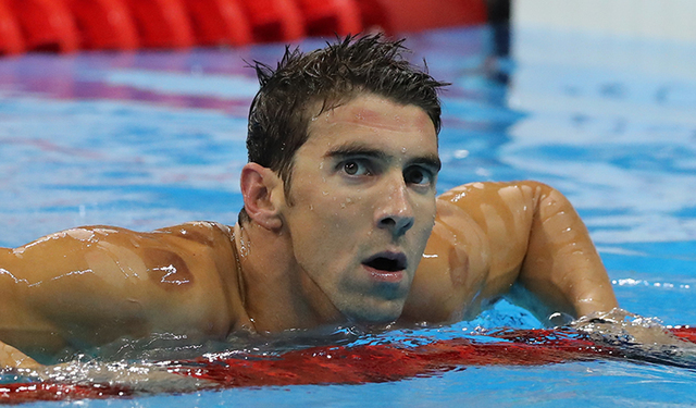 United States' Michael Phelps celebrates winning a semifinal of the men's 200-meter individual medley during the swimming competitions at the 2016 Summer Olympics, Wednesday, Aug. 10, 2016, in Rio ...