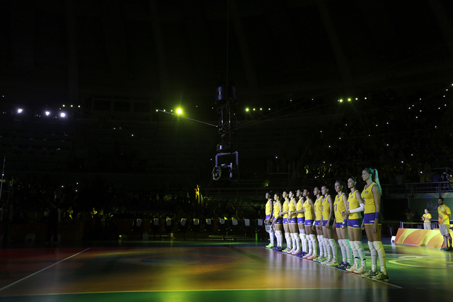 Members of team Brazil are introduced before the start of a women's preliminary volleyball match against Japan at the 2016 Summer Olympics in Rio de Janeiro, Brazil, Wednesday, Aug. 10, 2016. (AP  ...