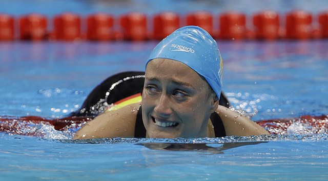 Spain's Mireia Belmonte Garcia cries after winning the gold in the women's 200-meter butterfly during the swimming competitions at the 2016 Summer Olympics, Wednesday, Aug. 10, 2016, in Rio de Jan ...