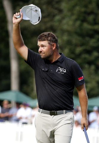 Ryan Moore waves on the 18th hole after he won the final round of the John Deere Classic golf tournament Sunday, Aug. 14, 2016, in Silvis, Ill. (Nam Y. Huh/AP)