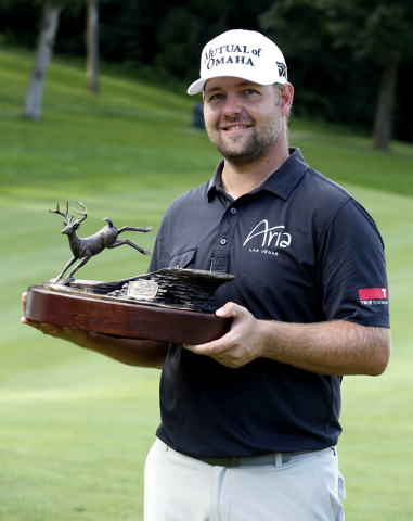 Ryan Moore poses with the trophy after winning the John Deere Classic golf tournament Sunday, Aug. 14, 2016, in Silvis, Ill. (Nam Y. Huh/AP)
