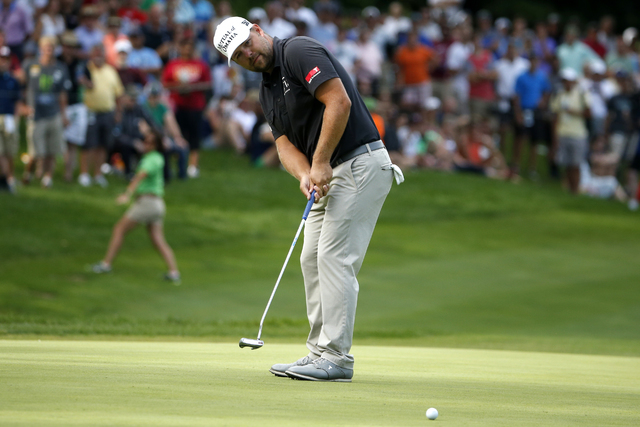 Ryan Moore watches his putt on the 18th hole green during the final round of the John Deere Classic golf tournament Sunday, Aug. 14, 2016, in Silvis, Ill. (Nam Y. Huh/AP)