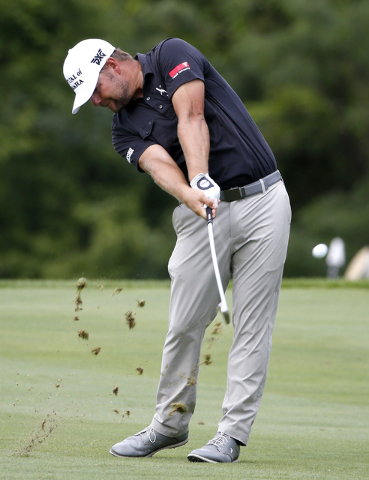 Ryan Moore hits from the 15th hole fairway during the final round of the John Deere Classic golf tournament Sunday, Aug. 14, 2016, in Silvis, Ill. Moore won the tournament. (Nam Y. Huh/AP)