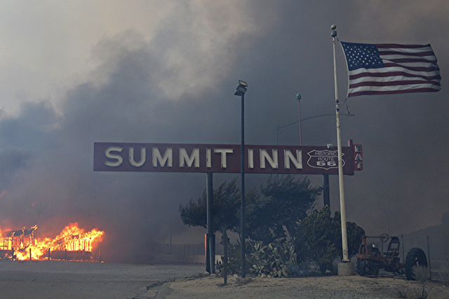This Tuesday, Aug. 16, 2016 photo shows the Summit Inn, a popular roadside diner at the crest of historic Route 66 in Oak Hills, Calif. burns to the ground after a fast burning wildfire swept thro ...