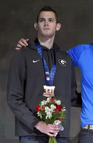 In this July 3, 2016 file photo, Gunnar Bentz stands with teammates during the men's 400-meter relay team medal ceremony at the U.S. Olympic swimming trials in Omaha, Neb. (AP Photo/Mark J. Terril ...