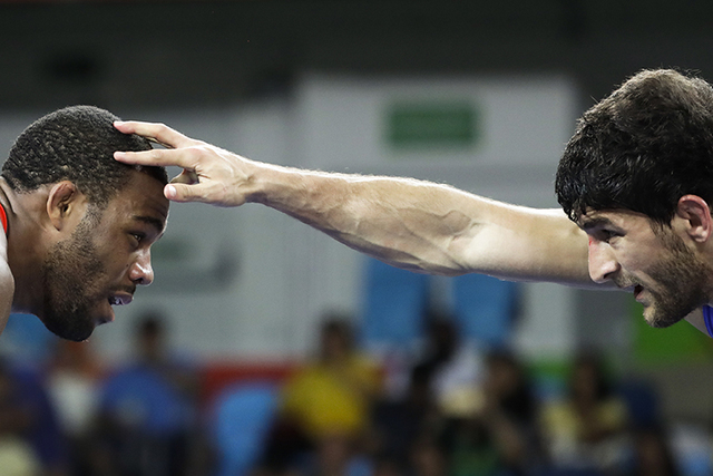 United States' Jordan Ernest Burroughs, red, competes against Russia's Aniuar Geduev during the men's 74-kg freestyle wrestling competition at the 2016 Summer Olympics in Rio de Janeiro, Brazil, F ...