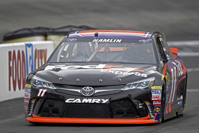 Denny Hamlin makes his way down pit road during practice for a NASCAR Sprint Series auto race on Friday, Aug. 19, 2016 in Bristol, Tenn. (AP Photo/Wade Payne)