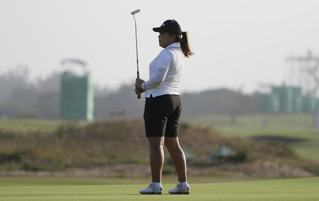 Inbee Park of South Korea pauses on the 18th hole as she finishes the third round of the women's golf event at the 2016 Summer Olympics in Rio de Janeiro, Brazil, Friday, Aug. 19, 2016. (AP Photo/ ...