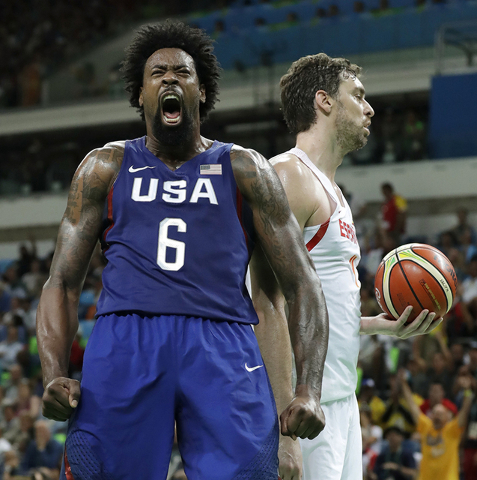 United States' DeAndre Jordan (6) celebrates in front of Spain's Pau Gasol, right, after dunking the ball during a semifinal round basketball game at the 2016 Summer Olympics in Rio de Janeiro, Br ...