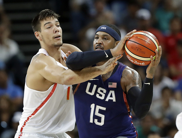 United States' Carmelo Anthony (15) is pressures by Spain's Willy Hernangomez (14) during a men's semifinal round basketball game at the 2016 Summer Olympics in Rio de Janeiro, Brazil, Friday, Aug ...