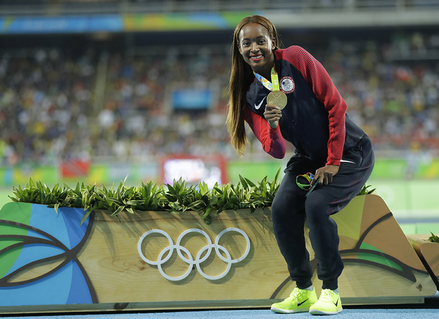 United States' gold medal winner Dalilah Muhammad poses for a photograph during the medal ceremony for the women's 400-meter hurdles race during the athletics competitions of the 2016 Summer Olymp ...