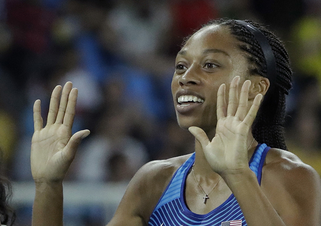 United States' Allyson Felix smiles after winning the gold in the women's 4x100-meter final during the athletics competitions of the 2016 Summer Olympics at the Olympic stadium in Rio de Janeiro,  ...