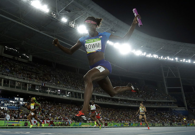 United States's Tori Bowie crosses the line to win the gold medal in the women's 4x100-meter relay during the athletics competitions of the 2016 Summer Olympics at the Olympic stadium in Rio de Ja ...