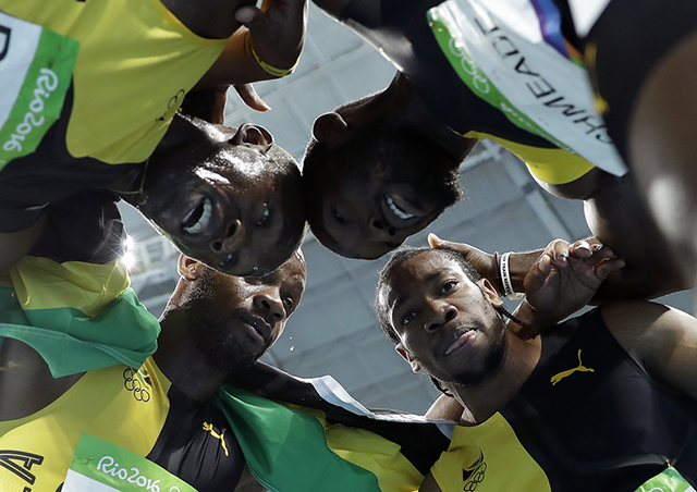 Jamaica's Asafa Powell, Yohan Blake, Nickel Ashmeade and Usain Bolt celebrate winning gold in the men's 4 x 100-meter relay final, during the athletics competitions of the 2016 Summer Olympics at  ...
