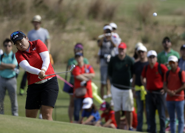 Inbee Park of South Korea hits on the 7th hole during the final round of the women's golf event at the 2016 Summer Olympics in Rio de Janeiro, Brazil, Saturday, Aug. 20, 2016. (Chris Carlson/The A ...