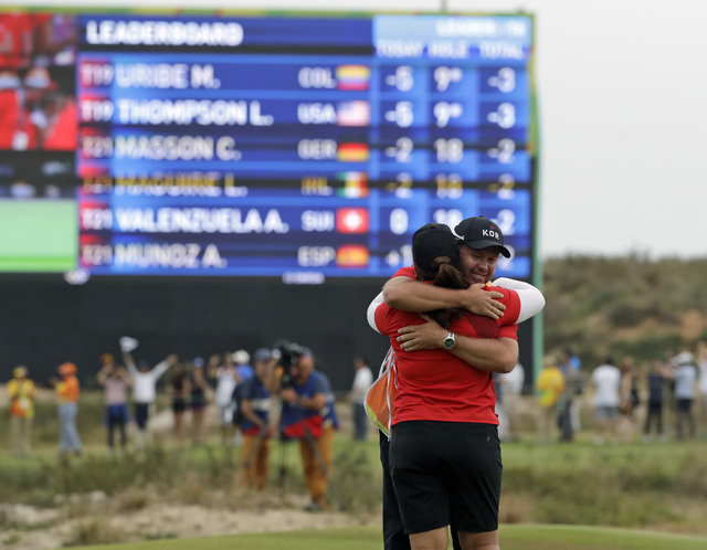 Inbee Park of South Korea, hugs her caddie after she won the gold medal during the final round of the women's golf event at the 2016 Summer Olympics in Rio de Janeiro, Brazil, Saturday, Aug. 20, 2 ...