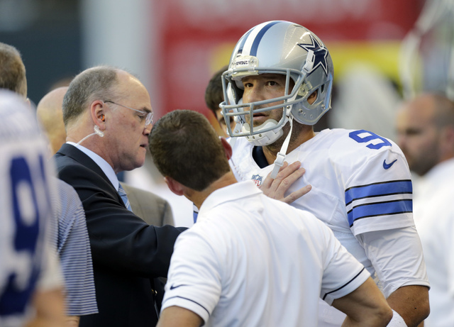 Dallas Cowboys quarterback Tony Romo is examined on the sideline after he left the game with an injury during the first half of a game against the Seattle Seahawks, Thursday, Aug. 25, 2016, in Sea ...