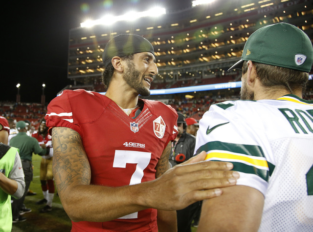 San Francisco 49ers quarterback Colin Kaepernick, left, greets Green Bay Packers quarterback Aaron Rodgers at the end of their game Friday, Aug. 26, 2016, in Santa Clara, Calif. Green Bay won 21-1 ...