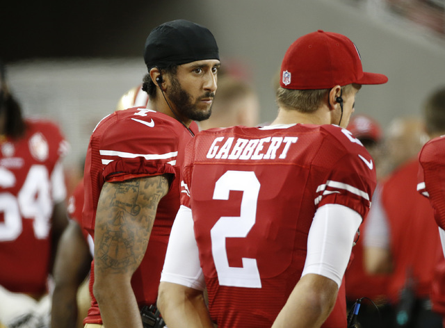 San Francisco 49ers quarterbacks Colin Kaepernick, left, and Blaine Gabbert stand on the sideline during the second half against the Green Bay Packers on Friday, Aug. 26, 2016, in Santa Clara, Cal ...