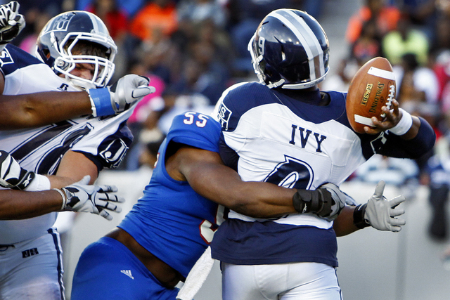 Tennessee State's Anthony Bass (55) hits Jackson State quarterback LaMontiez Ivy while throwing the ball during the first half of the 25th Annual Southern Heritage Classic football game at Liberty ...
