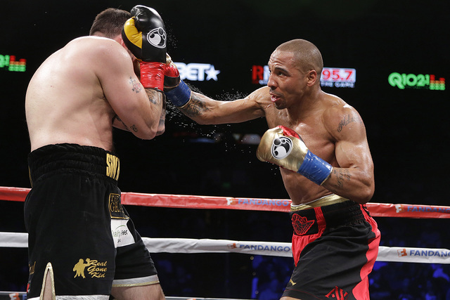 Andre Ward, right, punches Paul Smith during a cruiserweight boxing match in Oakland, Calif., Saturday, June 20, 2015. Ward won when Smith's corner threw in the towel in the ninth round. (Jeff Chi ...
