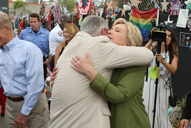 Democratic presidential candidate Hillary Clinton embraces Orlando Mayor Buddy Dyer after laying a bouquet of flowers at the memorial outside of the Pulse nightclub in Orlando, Fla. Friday, July 2 ...