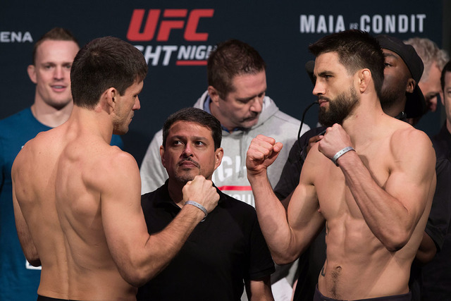 Demian Maia, left, of Brazil, and Carlos Condit, of the United States, pose during the weigh-in for a UFC Fight Night event in Vancouver, British Columbia, Friday, Aug. 26, 2016. (Darryl Dyck/The  ...
