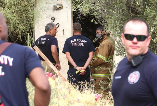 Clark County firefighters survey the damage of a house fire at 901 Apache Lane on Monday, Aug. 1, 2016. (Bizuayehu Tesfaye/Las Vegas Review-Journal Follow @bizutesfaye)