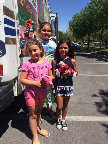 Sisters Anna Balian, Serenity Kline and Mikaela Kline hold the puppets they created during a recent Artz-to-Go class at Bruce Trent Park.  (Joan Patterson/Special to the Las Vegas Review-Journal)