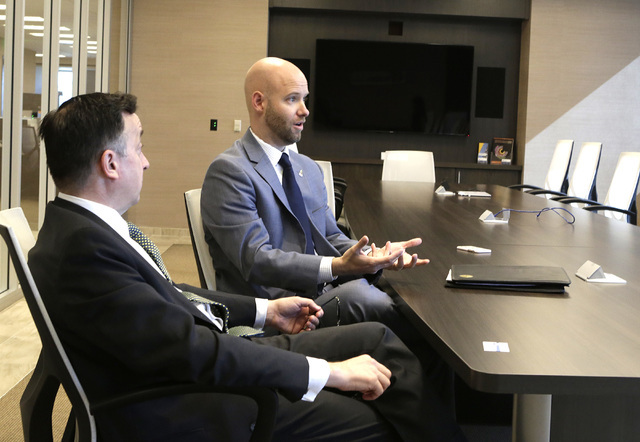 The Las Vegas Global Economic Alliance vice chairman, John Delikanakis, left, listens as president & CEO, Jonas Peterson, speaks during an interview at the company's conference room on Thursda ...