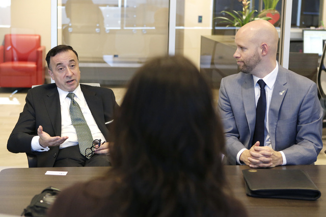 The Las Vegas Global Economic Alliance vice chairman, John Delikanakis, left, speaks as president & CEO, Jonas Peterson, looks on during an interview at the company's conference room on Thursd ...
