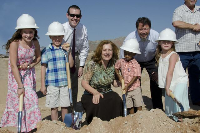 Future students of the new elementary school near Antelope Ridge and Desert Foothills pose for a photo with CCSD Academic Manager Dr. Jesse Welsh (left), CCSD Board of School Trustees Clerk Patric ...