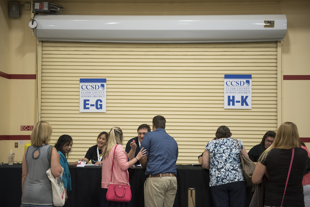CCSD incoming teachers register for badges during a Clark County School District event to launch the 2016-17 academic year at the South Point hotel-casino in Las Vegas on Wednesday, Aug. 17. 2016. ...