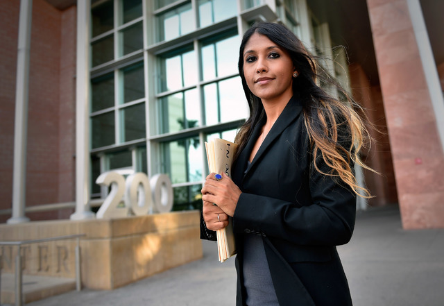 Deputy Public Defender Zohra Bakhtary stands in front of the Regional Justice Center Tuesday, Aug. 2, 2016, in Las Vegas. A judge on Tuesday threw out a contempt charge against the woman, who was  ...