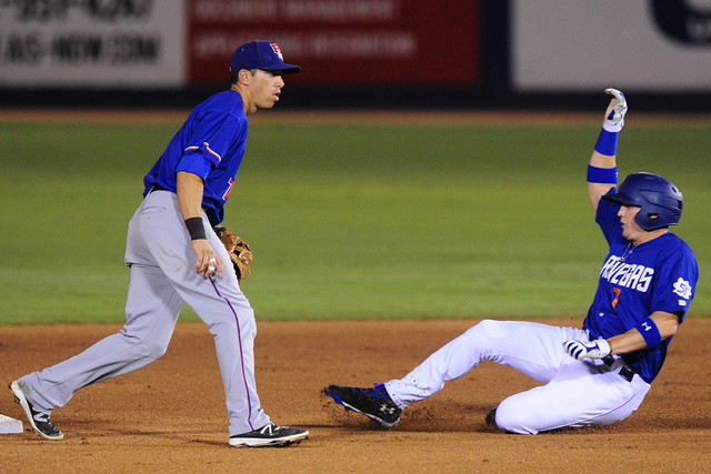 Las Vegas base runner Brandon Nimmo steals second base in front of Round Rock second baseman Doug Bernier in the fourth inning at Cashman Field in Las Vegas Tuesday, August 16, 2016. Las Vegas won ...