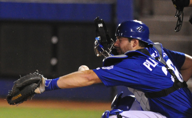 The mask worn by Las Vegas catcher Kevin Plawecki flies off after it was hit by a Round Rock foul ball in the fifth inning at Cashman Field in Las Vegas Tuesday, Aug. 16, 2016. Las Vegas won 7-5 i ...