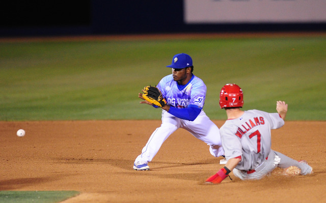 Las Vegas 51s second baseman Dilson Herrera tags out Memphis Redbirds base runner Matt Williams after Williams tried to steal second base in the seventh inning of their minor league baseball game  ...