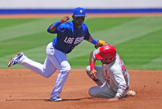 Memphis Redbirds base runner David Washington steals second base while Las Vegas 51s second baseman Dilson Herrera applies the tag in the first inning of their Triple-A minor league baseball game  ...