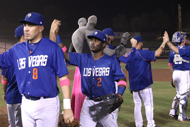Niuman Romero and Dilson Herrera celebrate their 16-8 victory over the Sacramento River Cats at Cashman Field in Las Vegas on Saturday, June 25, 2016. Loren Townsley/Las Vegas Review-Journal Follo ...