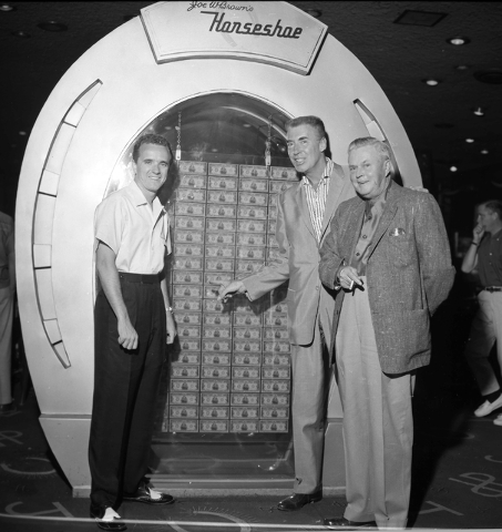 Joe W. Brown, right, poses with bandleader Art Mooney, center and another man at Binion's Horseshoe hotel-casino in front of a display of 100 $10,000 bills in this Las Vegas News Bureau photo from ...