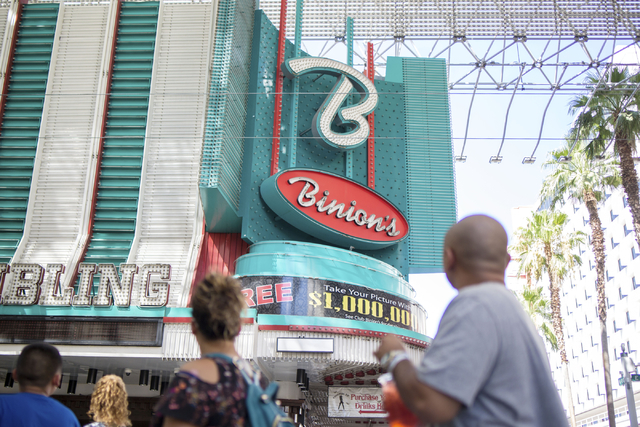 Pedestrians walk by the historical Binion's Gambling Hall & Hotel on Thursday, Aug. 11, 2016, in Las Vegas. Elizabeth Page Brumley/Las Vegas Review-Journal Follow @ELIPAGEPHOTO