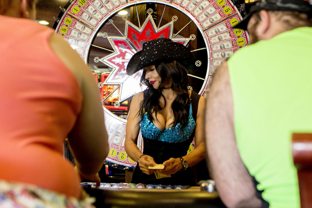 Norma Goh, Big 6 dealer, deals the game in Binion's Gambling Hall & Hotel Thursday, Aug. 11, 2016, in Las Vegas. Elizabeth Page Brumley/Las Vegas Review-Journal Follow @ELIPAGEPHOTO